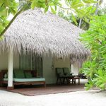 coastal chic or beach house vibe in Vakarufalhi Maldives luxury villa